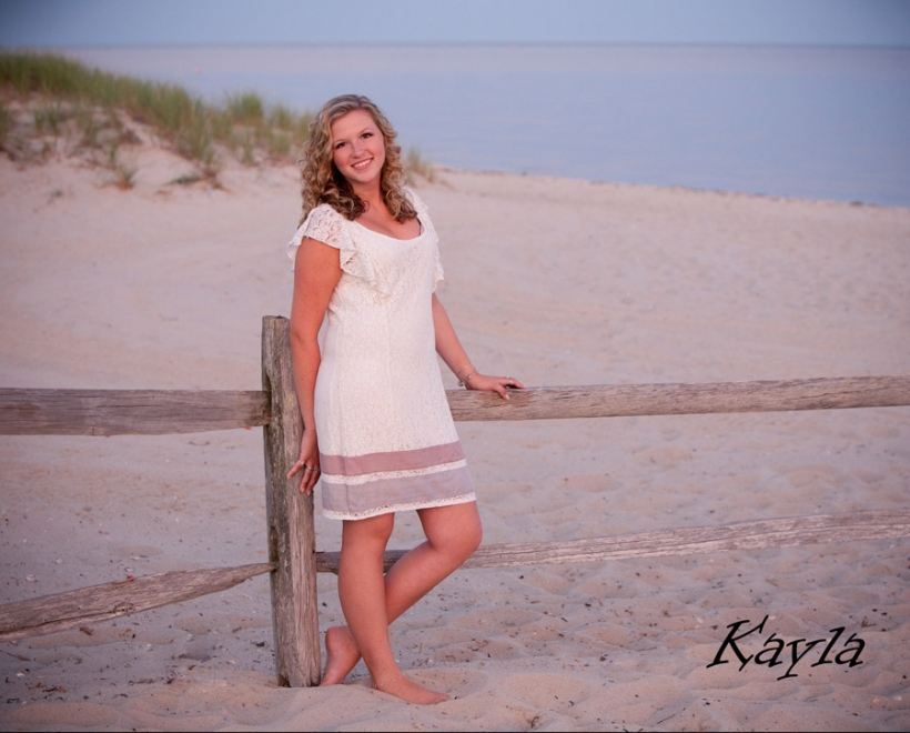 senior photo on beach at sunset