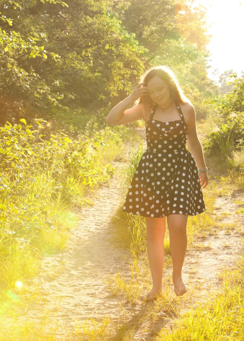 portrait of teen with lens flare from sun