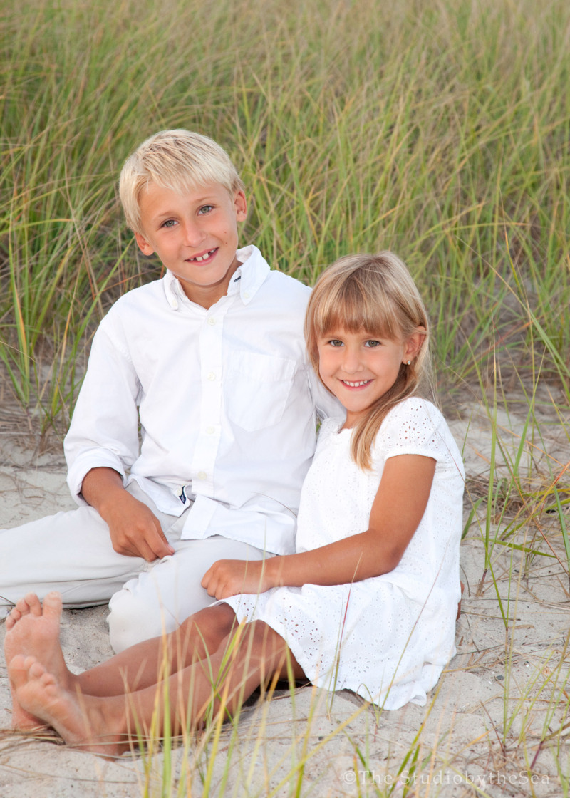 Brother and sister on the beach portrait