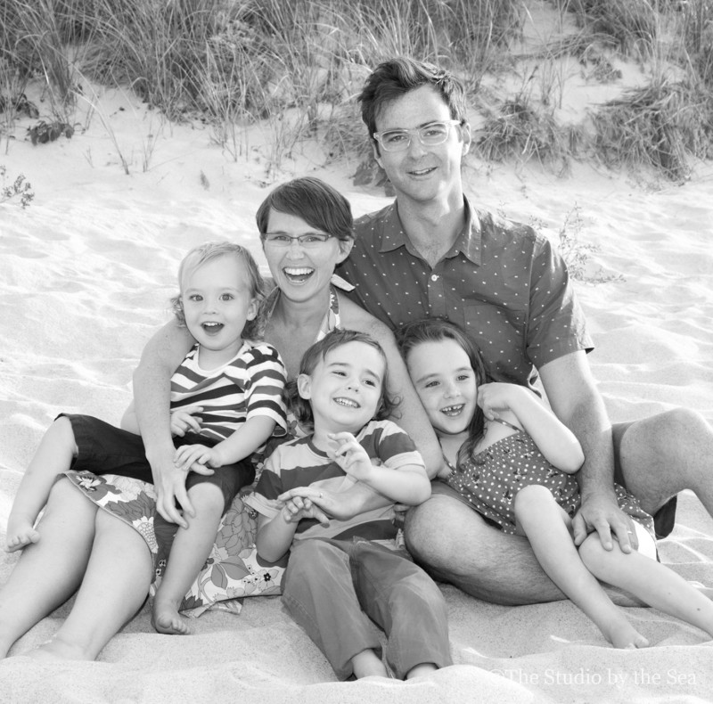 family laughing on the beach