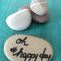 rocks with #happyday written on