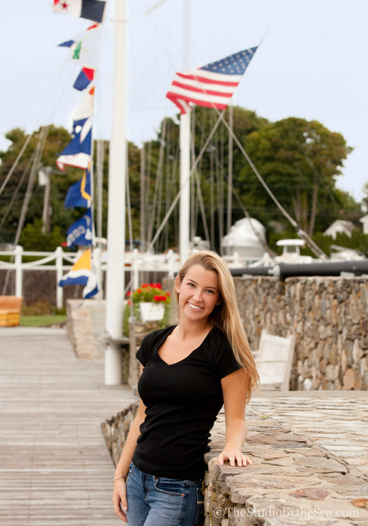 Teen standing in front of nautical flags
