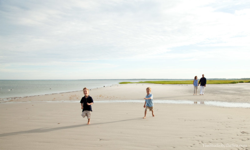 two boys running on beach