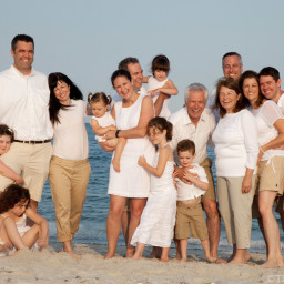 large casual family portrait on beach