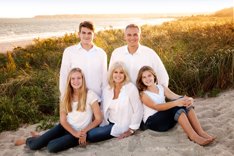Family portrait at sunset on the beach