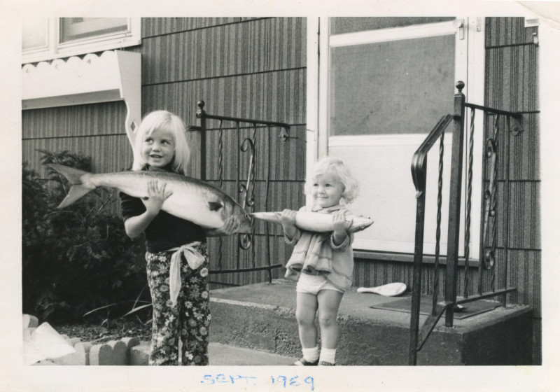 Old photo young girls holding big fish